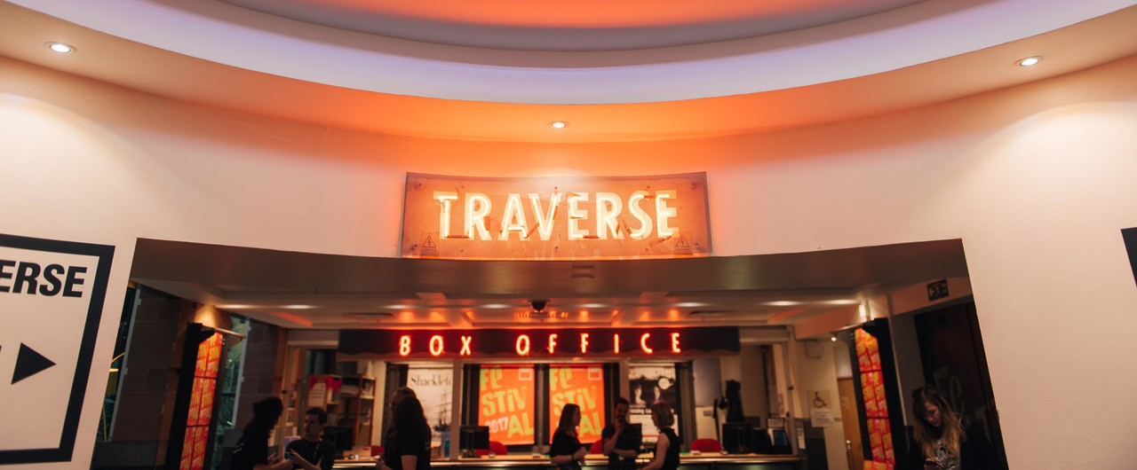 Traverse Theatre entrance. A neon sign reading 'Traverse' is visible.
