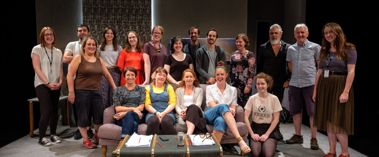 Team photo of Traverse Theatre staff, cast and crew members of Ulster American.