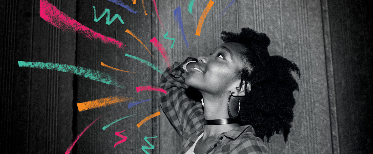 A young person smiles. Multi-Coloured graphic arrows surround her.