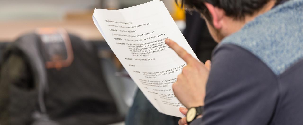Actor reading a script.