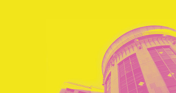 Exterior photo of the Traverse Theatre. The image has been treated with a vibrant yellow and pink wash.
